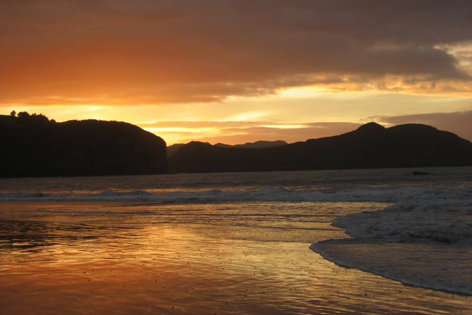 Sonnenuntergang in Tauranga Bay